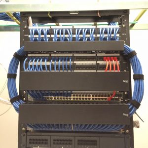 two post rack with neatly dressed patch cables